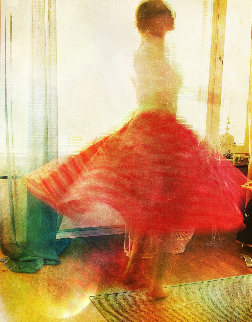"""girl in vintage dress spinning around"", photograph"