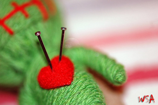 &quot;photo of voodoo doll with needles in heart&quot;