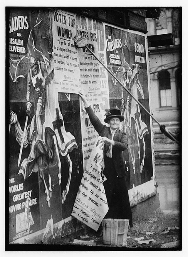 suffragette posting bills